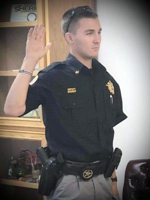"""The late Joshua Bryan """"LJ"""" Ryer Jr. taking his oath of office."""