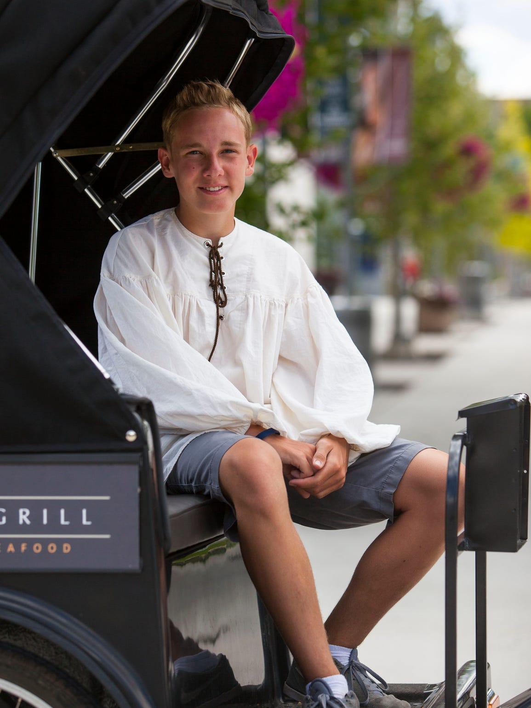 Caleb Nelson, owner of Romeo's Rickshaws, poses for