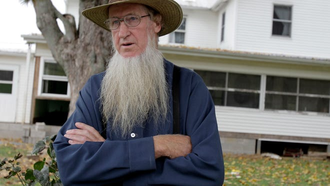 In this Oct. 10, 2011 file photo, Sam Mullet stands in front of his home in Bergholz, Ohio. (AP)