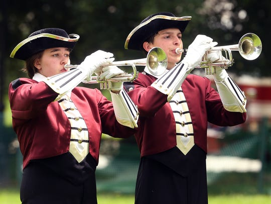 Morristown High School buglers Conor Lenahan, left,