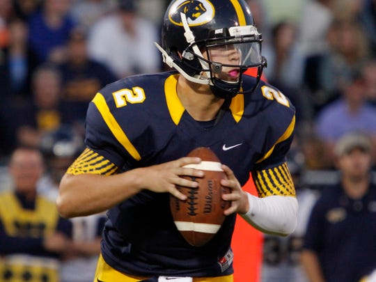 DeWitt quarterback Jake Johnson rolls out against Haslett Sept. 26 in DeWitt. Johnson missed several games of his senior season but said he expects to sign his letter of intent next month to play at Central Michigan University.