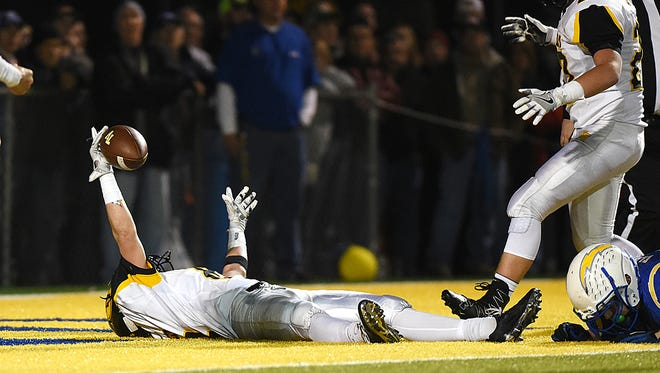 Tri-Valley's Caleb Craig lays on his back in the end zone after scoring against Tri-Valley last year.  Philo and Tri-Valley are coming off a season in which they shared the league title and the two will face off on Friday.