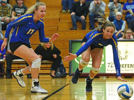 O'Gorman's Emma Ronsiek (9) misses the ball during a match against Roosevelt Tuesday, Oct. 11, 2016, at Roosevelt High School in Sioux Falls.