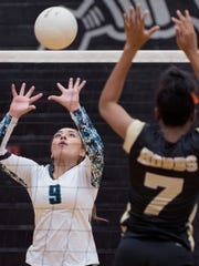 Onate's Idali Enriquez tries to push the ball to the
