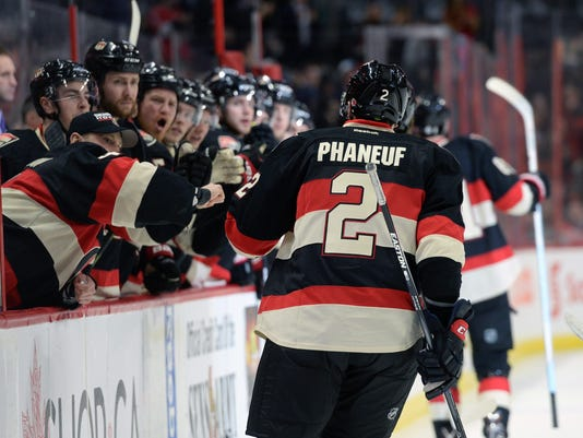 Ottawa Senators' Dion Phaneuf, gets high-fives from his new teammates as he celebrates a goal against the Colorado Avalanche during second period NHL hockey action in Ottawa, Canada, Thursday, Feb. 11, 2016. Phaneuf recorded an assist on the goal. (Sean Kilpatrick/The Canadian Press via AP) MANDATORY CREDIT