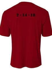 The back of the shirt has the date of the deadly attack