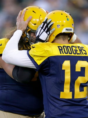 Green Bay Packers quarterback Aaron Rodgers  and tackle David Bakhtiari following a second half touchdown.The Green Bay Packers host the San Diego Chargers, Sunday, October 18, 2015 at Lambeau Field in Green Bay, Wis.