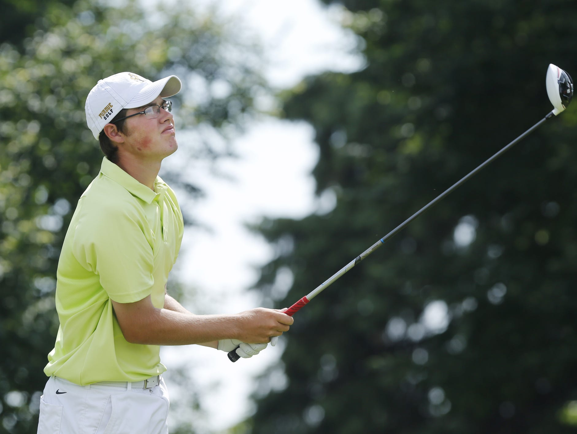 Harrison's Cole Bradley watches his drive at the par four at No. 4 during the golf regional Wednesday, June 10, 2015, at Battle Ground Golf Club.