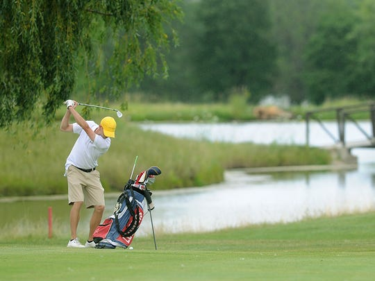 A golfer plays at Rolling Meadows Golf Course.