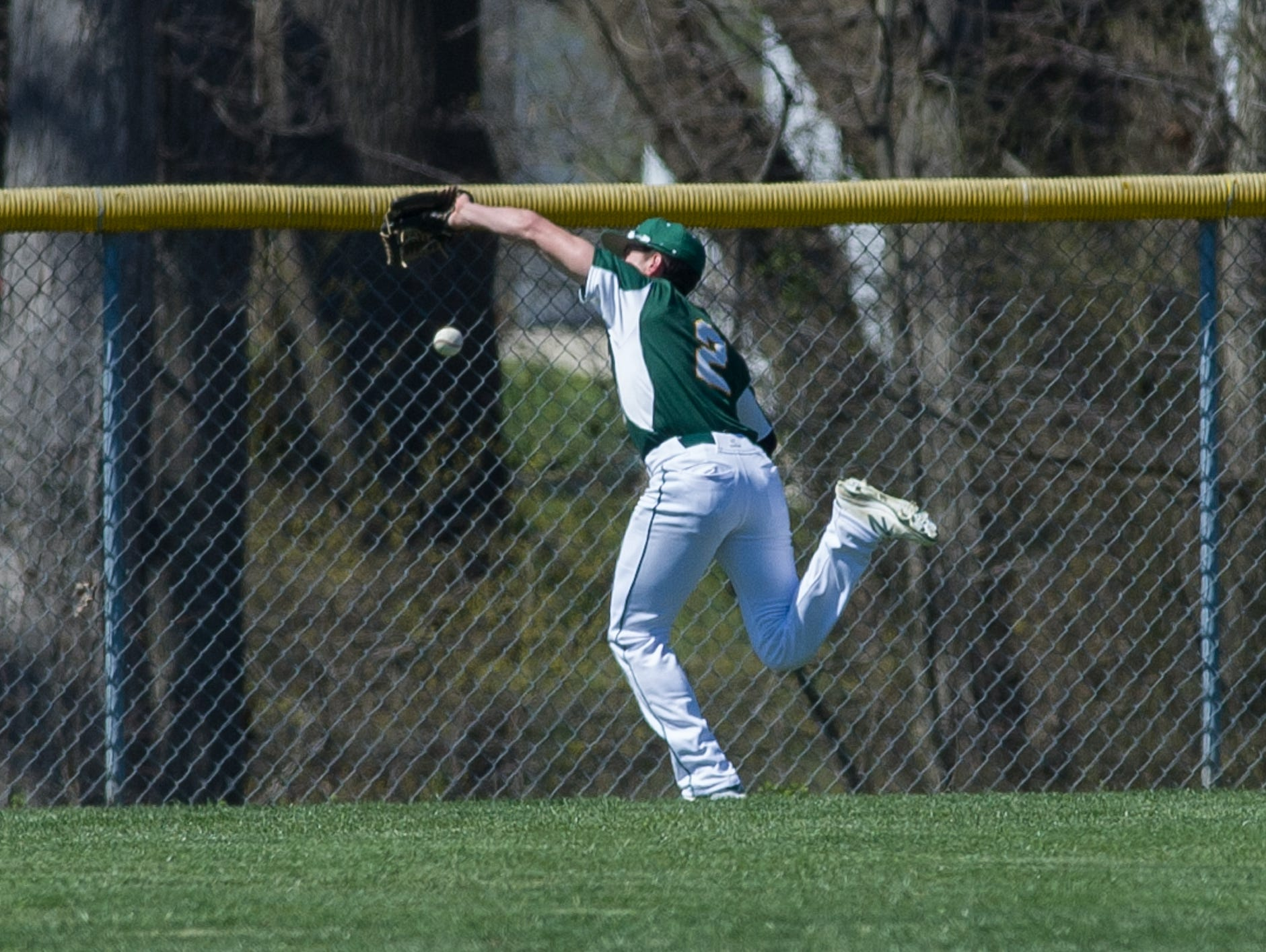 St. Mark's Austin Colmery (2) misses a fly ball to left field in their game against Caesar Rodney.