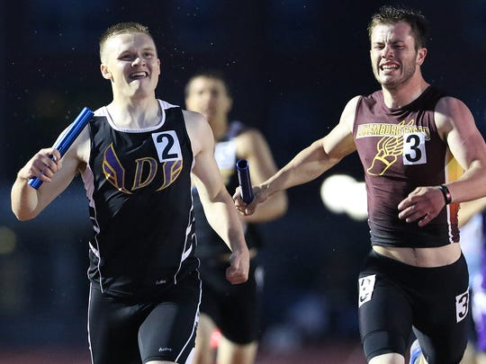Denmark's Zachary Pantzlaff, left, and Luxemburg-Casco's Sam Larson compete in the WIAA Division 3 1600 meter relay at the state track and field meet June 3, at the Veterans Memorial Stadium Complex in La Crosse.