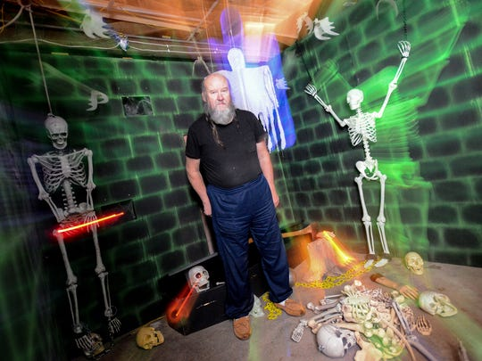 Jim Snellenburger stands in his haunted house Thursday,
