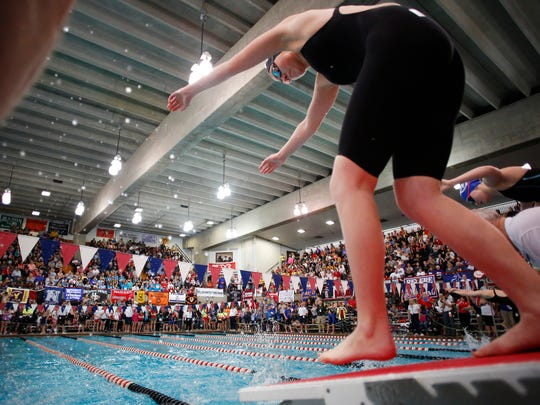Colonel Crawford's Madison Sharp takes off from the blocks in last season's state swim meet.