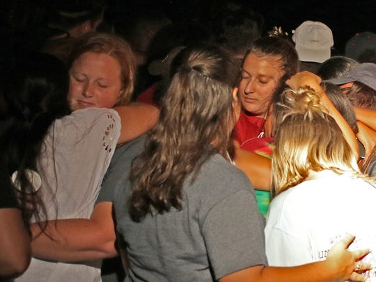 Students console each other at Robert Grays candlelight
