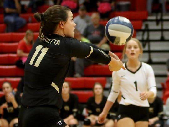Henrietta's Maddie Brown hits the ball back over to Holliday Tuesday, Oct. 24, 2017, in Holliday.