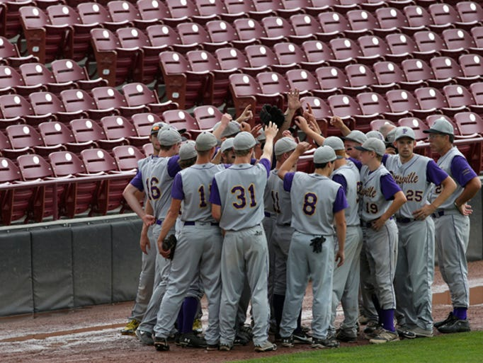Pittsville High School comes together as a team prior to taking to the field against Lake Country Lutheran High School during their WIAA Division 4 semifinal state baseball tournament game, Wednesday, June 18, 2014, at Grand Chute'??s Neuroscience Group Field at Fox Cities Stadium, Wis.