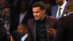 Trae Young reacts after being drafted fifth overall