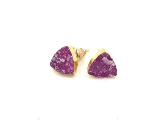 Pink druzy triangle earrings — which are stainless steel, gold plated — are available at www.ashleygold.com for $35. The 15% off promo code takes $5.25 off. Code: Valentine.