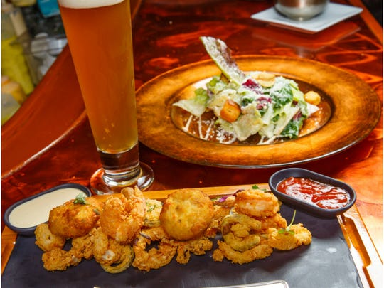 Calamari at Chops City Grill is just one of many appetizer specials extended through through Oct. 30 at all Culinary Concepts restaurant bars. Appetizers are now 25 percent off, plus happy hour drink specials are available all night at the bars.