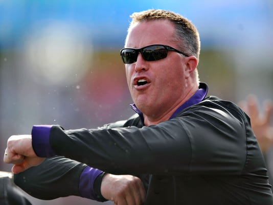 FILE - In this Saturday, Oct. 22, 2016, file photo, Northwestern head coach Pat Fitzgerald yells to his players during the second quarter of an NCAA college football game against Indiana in Evanston, Ill. One of the greatest players in Northwestern history and a local guy to boot, Fitzgerald has become synonymous with success at a program that has had very little when he has not been involved. (AP Photo/Paul Beaty, File)