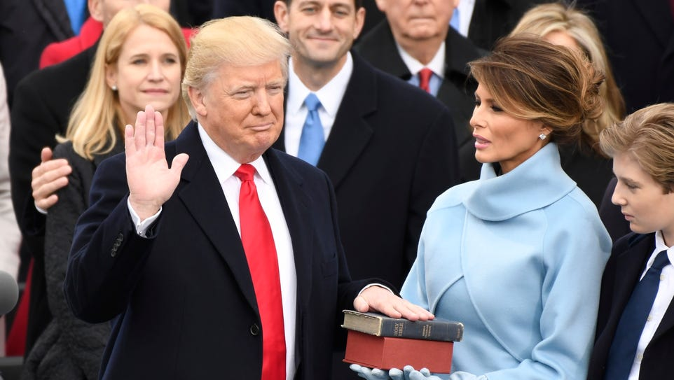 Donald Trump takes the oath of office.