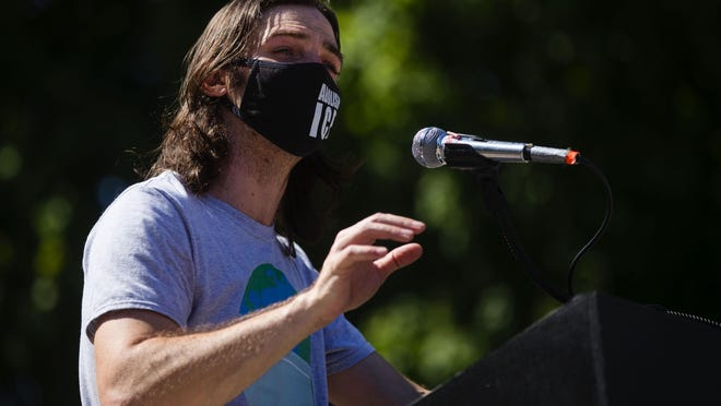 """Organizer John Keating speaks during the """"Manifesting Our Momentum"""" event at the Lincoln statue in front of the Illinois Capitol building on Sunday, June 7. Keating launched a new organization Sunday called Education & Action Together (EAT) which address people's civil rights and interaction with police in a series of teach-ins."""