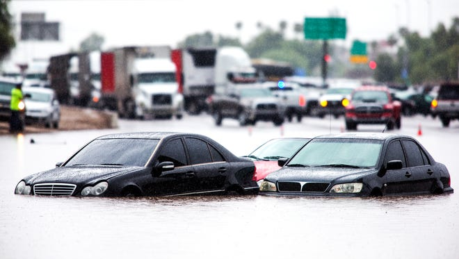"""Lawmakers in 1995 passed what is known as the """"stupid motorist law,"""" which states anyone who drove around barricades into a flooded wash can be held liable for the cost of the rescue."""