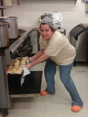 Candida is working on earning her NCRC;  she works as a trustee in the kitchen by day and does her studies at night.