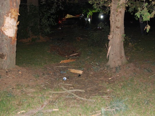 A pickup hit two trees Saturday morning before coming to rest nearby, according to police.