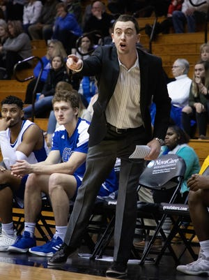 Grand Valley State men's basketball coach Taylor Johnson (center) was named to the NABC Under Armour 30-Under-30 Team.