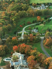 The Carmel homes of Scott Jones (bottom) and Stephen Hilbert (top) near 116th Street and Spring Mill Road are shown in this aerial photograph.