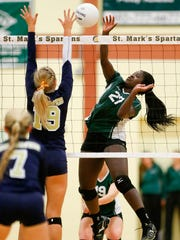 DMA's Cassie Kowalski (left) leaps against a kill attempt by Archmere's Zoe Akoto on Thursday in a state tournament semifinal at St. Mark's.