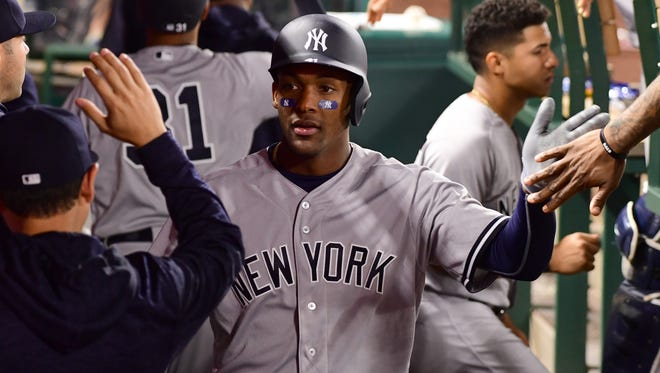 Apr 27, 2018; Anaheim, CA, USA; New York Yankees third baseman Miguel Andujar (41) is greeted in the dugout after scoring a run in the fifth inning of the game against the Los Angeles Angels at Angel Stadium of Anaheim.