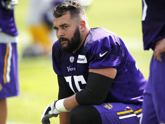 Minnesota Vikings tackle Alex Boone (75) attends the
