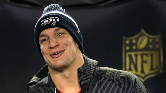 New England Patriots tight end Rob Gronkowski faces reporters before an NFL football practice, Thursday, Jan. 21, 2016, in Foxborough, Mass. The Patriots are to play the Denver Broncos in the AFC Championship on Sunday in Denver.