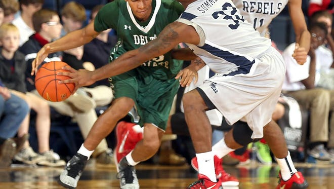 Ole Miss guard Jarvis Summers, right, defends a Delta State guard during the teams' exhibition Friday.