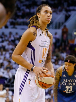 Phoenix Mercury center Brittney Griner (42) shoots a foul shot against Minnesota Lynx  in the second half of Game 1 of the WNBA Western Conference finals, Friday, Aug. 29,  2014 in Phoenix, Ariz. The Mercury won 85-71.