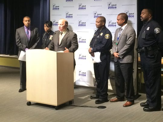 Detroit Mayor Mike Duggan (at podium) and other city officials including Police Chief James Craig (far left) on Wednesday, March 11 2015, at Detroit Public Safety Headquarters announce a pilot program outfitting 20 police officers in the city's 11th precinct with body-mounted cameras for 90 days.