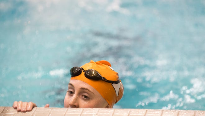 Tennessee's Alex Cleveland waits at the poolside after competing in the Women's 100 Yard Freestyle during Tennessee's swim meet against Florida at Allan Jones Aquatic Center on Friday, January 26, 2018.