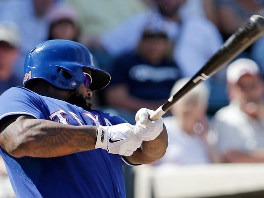 Texas Rangers' Prince Fielder hits a single during the fifth inning of a spring exhibition baseball game against the Milwaukee Brewers Friday, March 21, 2014, in Surprise, Ariz. (AP Photo/Darron Cummings)