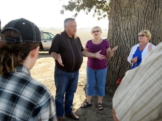 Dennis Sutherland, center, lead Pastor at Bethel Family Worship Center in Tulare, and a group of parishioners pray for a solution to their problem and for the Tulare City Council to make the right decisions, south of Cartmill Avenue and north of the Tulare Outlet Center, along Retherford Street. Also pictured is Dennis' wife, Marilyn Sunderland, center-right, and Pam Malloy.