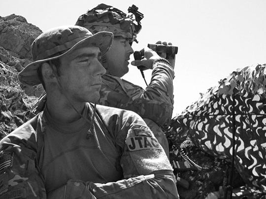"""Second Lt. Andrew Dane stands watch while deployed as a Tactical Air Control Party specialist. In recounting his experience as a TACP specialist, Dane said """"I could still wear my beret and blouse my boots, I feel like (this) was fit for me."""""""