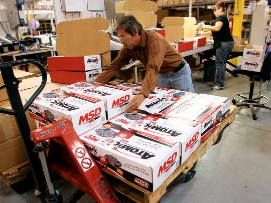 A worker loaded boxes at the MSD manufacturing plant