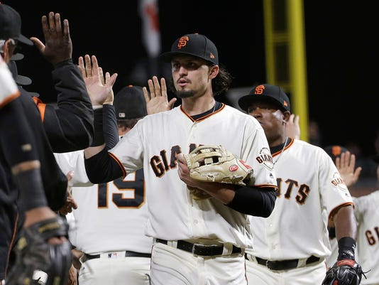 San Francisco Giants' Jarrett Parker, center, celebrates with teammates after a baseball game against the Oakland Athletics in San Francisco, Thursday, Aug. 3, 2017. The Giants won 11-2. (AP Photo/Jeff Chiu)