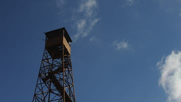 The old forest fire lookout tower near Sugar Grove is about 110-feet high. It was built in 1937, and is topped by a 7-by 7-foot cab.