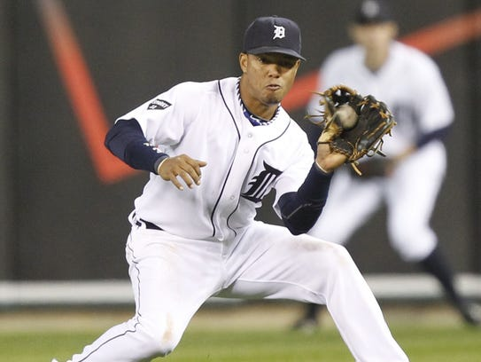Detroit Tigers Ramon Santiago snags a ground ball during