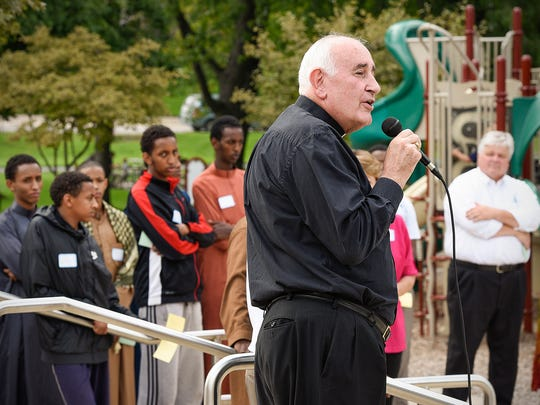 Bishop Donald J. Kettler welcomes everyone gathered for the Greater St. Cloud Faith Leaders interfaith picnic Sunday, Aug. 28, 2016, at Lake George.