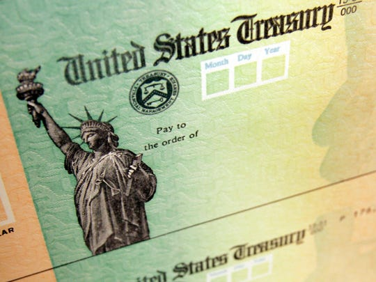 The FBI and top cops in states are warning consumers: Beware of stimulus check scammers