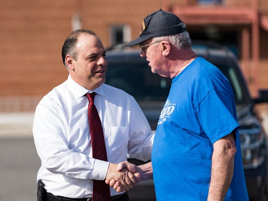 John Marino shakes hands with Steve Beaston, a campaign volunteer from Delaware City, at Everett Meredith Middle School in Middletown on Saturday, Feb. 25, 2017.