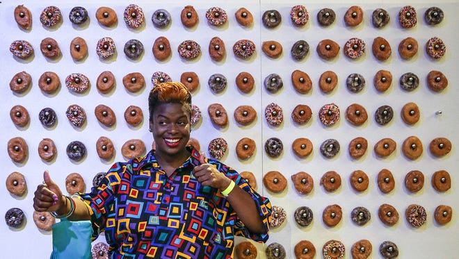 Samantha Ingram poses for a picture in front of the Jack's Donuts #babygotbrunch wall during Baby Got Brunch at the Pavilion at Pan Am, Indianapolis, Saturday, August 26, 2017. Indy's inaugural brunch fest benefited the Patachou Foundation, which helps feed Indianapolis children experiencing food insecurity.